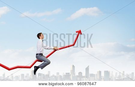 Concept of anti crisis with businessman that tames statistics diagram