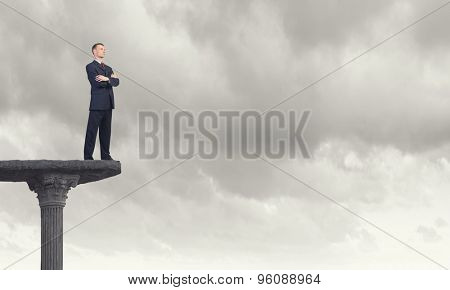 Full length of thoughtful businessman looking away