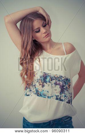 Beautiful teenage girl posing with hand in her hair