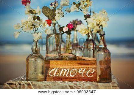 It is written on label word love flowers ocean water bottle