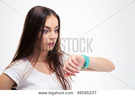 Attractive woman looking on her watch isolated on a white background