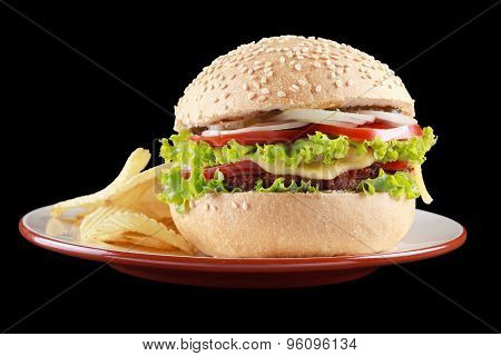 Burger And Potato Chips On A Plate.