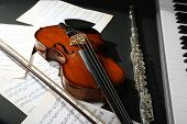 foto of wind instrument  - Musical instruments with music notes on dark background - JPG