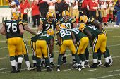 Green Bay Packers Huddling