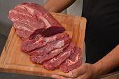 foto of crude  - Sliced crude beef steak meat - JPG