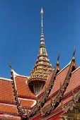 stock photo of buddhist  - Spire and roof of the Wat Chalong Buddhist temple in Chalong - JPG