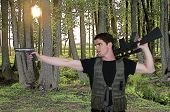 foto of rifle  - Handsome young man soldier with a pistol and rifle - JPG