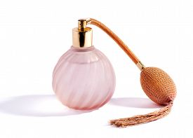 image of tassels  - Swirling decorative glass pink perfume bottle and atomizer with bulb and tassel for vintage style packaging of fragrance and scent on white with a shadow - JPG