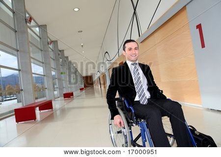 Businessman in wheelchair going to attend congress meeting
