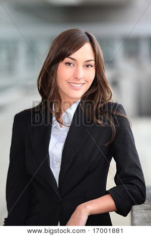 Closeup of beautiful businesswoman standing outside the office
