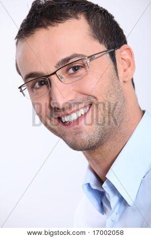 Closeup of smiling man with eyeglasses