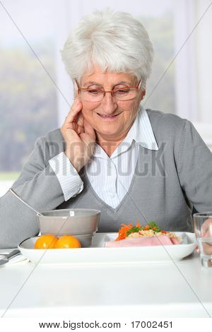 Old woman in nursing home ready to have dinner