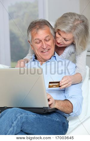 Senior couple doing on-line shopping