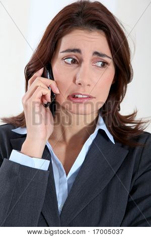 Businesswoman on the phone with preoccupied look