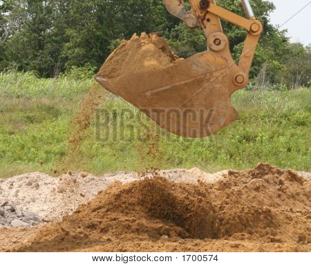 Loading Sand With Back Hoe
