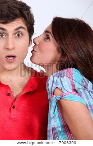 Young woman trying to give a kiss to her boyfriend