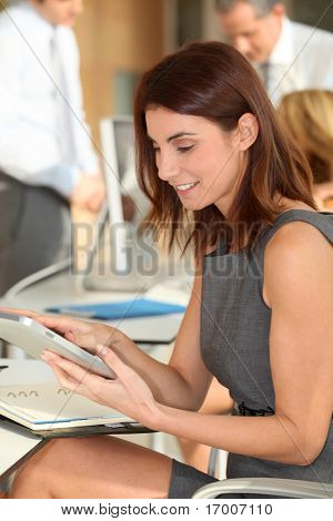 Executive woman working on electronic tab