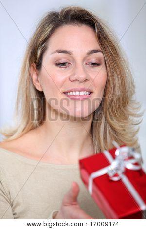 Closeup of woman reciving gift