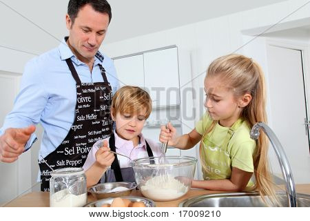 Father and children preparing pancakes