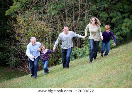 Family having fun running in park