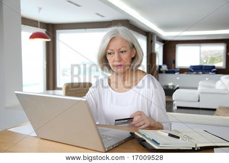 Senior woman doing online shopping at home