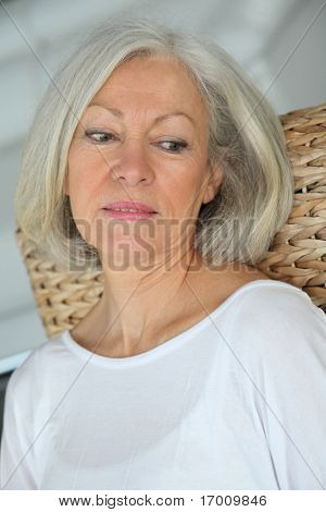 Closeup of senior woman relaxing at home