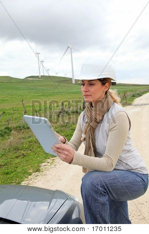Engineer in wind turbines field using electronic tablet