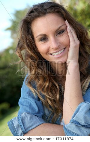 Portrait of beautiful woman relaxing in home garden