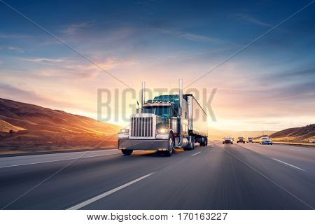 American style truck on freeway pulling load. Transportation theme. Road cars theme.