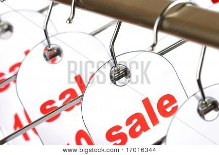 Sale. A hanger with labels on a white background.