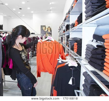 The girl in clothes shop.
