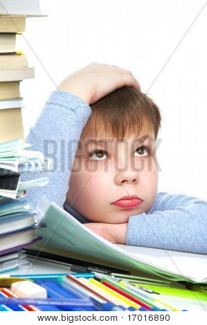 The boy behind a table with books