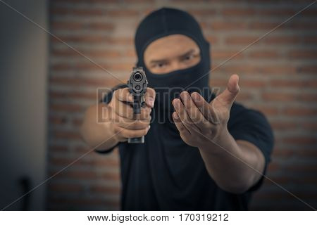 Thief pointing a