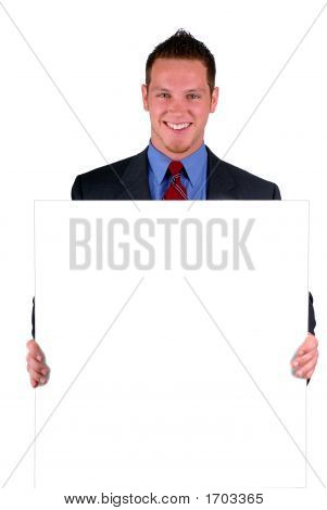 Businessman Holding A Sign