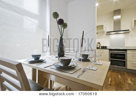 table setup with kitchen view