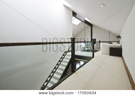 staircase to a loft room of a penthouse apartment