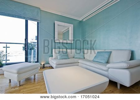 white leather sofa in a light blue living room