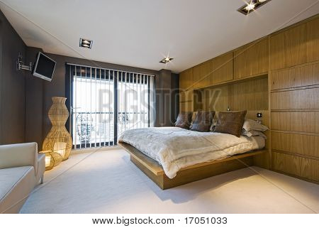 stunning luxury bedroom with a king size bed, wall mount plasma tv, sofa ...