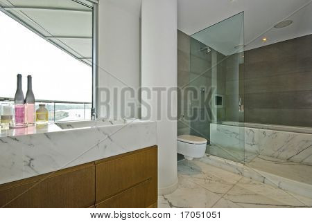 marble bathroom with floor to ceiling window, tv and sound system