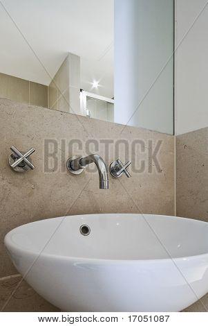 contemporary ceramic bathroom sink close up shot