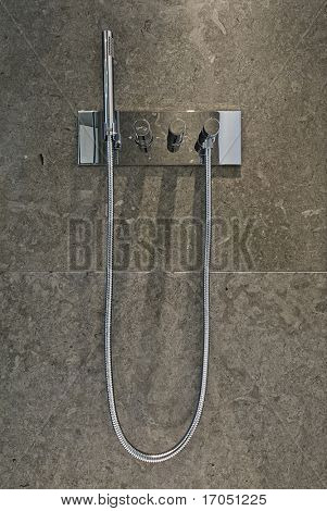 luxury chrome shower attachment on marble tiles