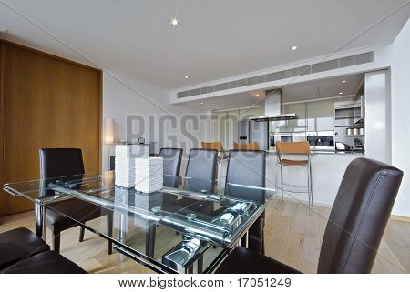 contemporary high spec dining area with open plan kitchen view