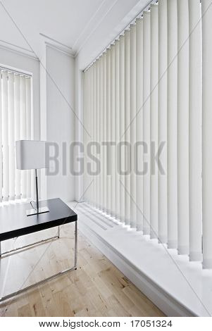 vertical fabric blinds on floor to ceiling windows