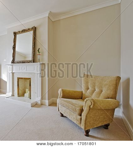 victorian style living room with a vintage armchair and fireplace