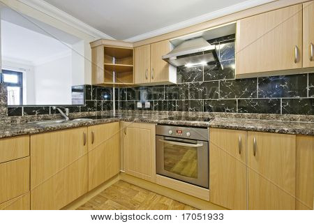 modern kitchen with granite worktop and serving window