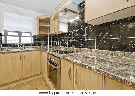 modern kitchen with granite worktop and serving window