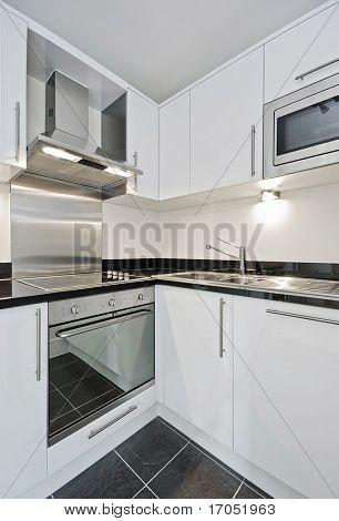 modern kitchen in white whit granite worktop