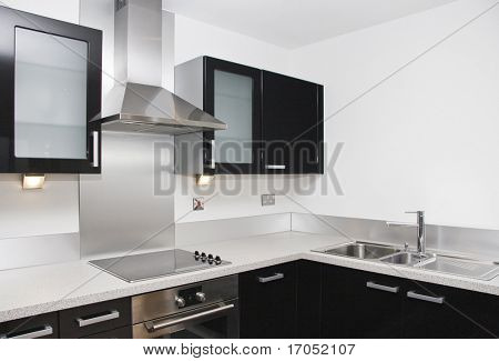 contemporary kitchen with a black piano finish and granite worktop