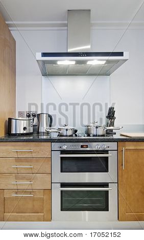 detail shot of modern electric stainless steel kitchen appliances