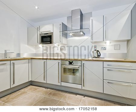 "modern kitchen counter in ""L"" shape with wooden worktop"
